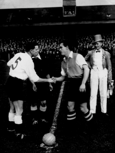 Arthur, wearing Blyth's changed kit of white shirts, greets the Hartlepools United captain